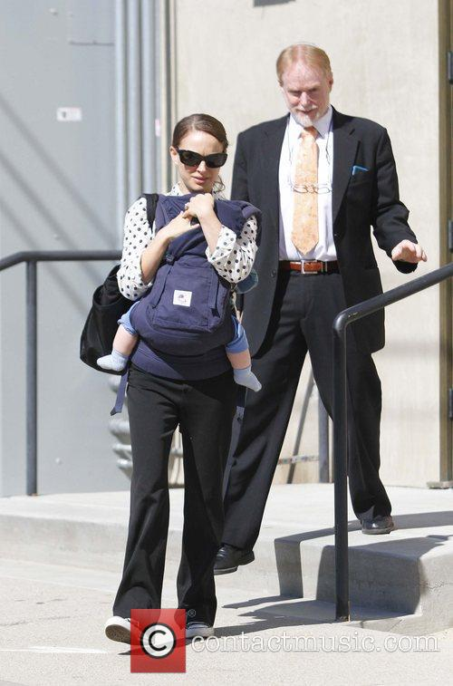 Natalie Portman carries her son Aleph in a...