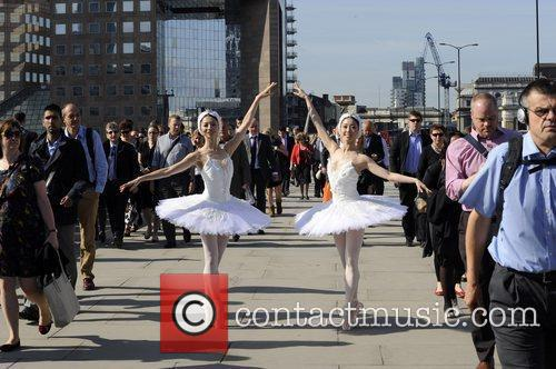 Performing for commuters on London Bridge. Both dancers...