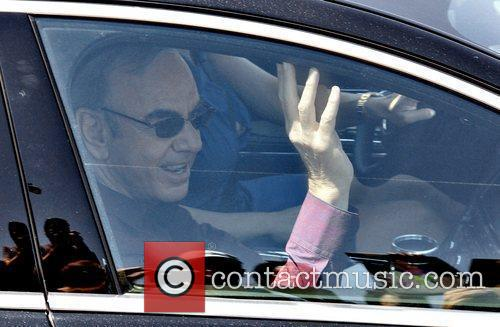 Neil Diamond waves from his car, after being...