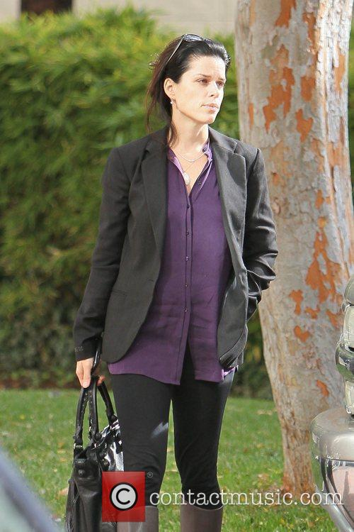 neve campbell arrives at an office building 5762610