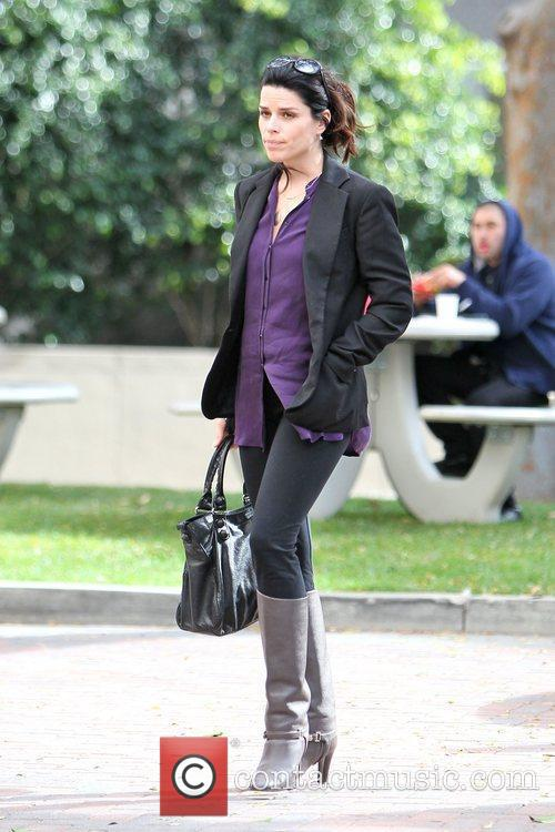 Arrives at an office building in Beverly Hills