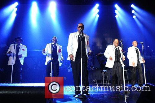 New Edition perform at Bank United Center in...