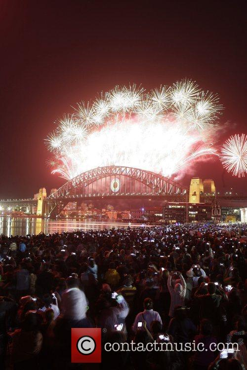 Fireworks explode over Sydney Harbour to celebrate the...