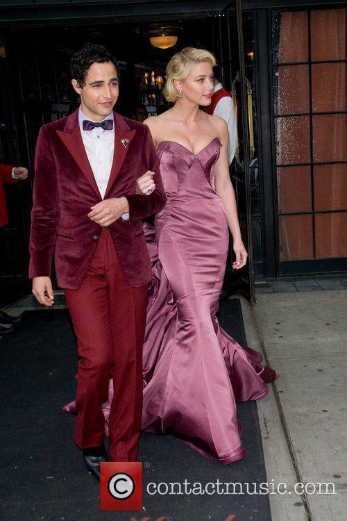 Zac Posen and Amber Heard leave their hotel...