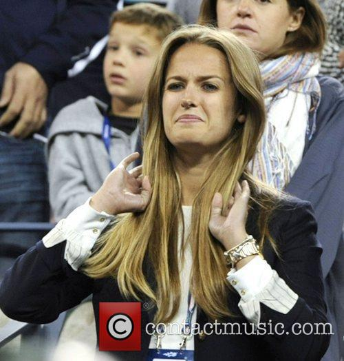 Kim Sears watches as  Andy Murray holds...