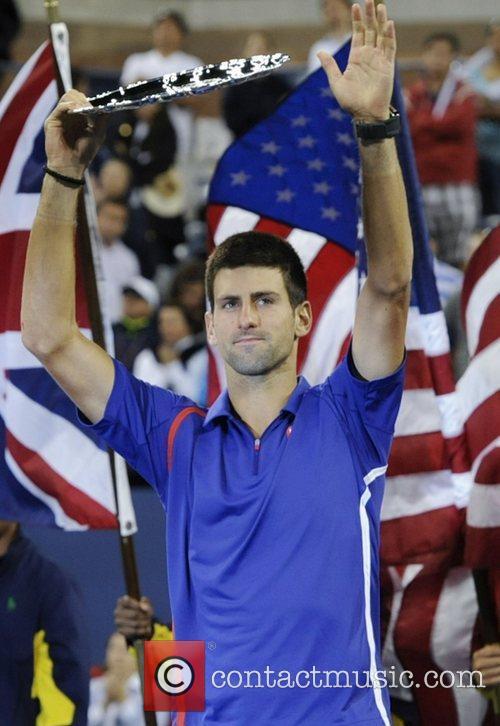 Novak Djokovic of Serbia lifts the runner's up...