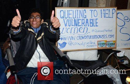 Eager Apple fan Zohaib Ali camps outside the...