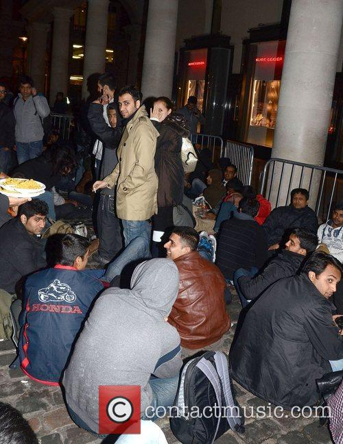 Eager Apple fans camp outside the Covent Garden...