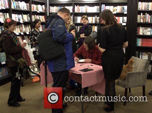 James Bowen signs book copies James Bowen and...