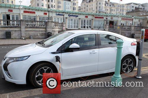 An electric car charging in Brighton Sussex, England
