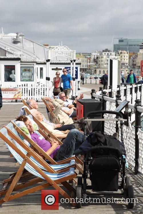 Sunbathers enjoy the sunny weather in Brighton