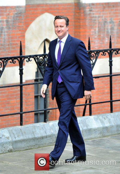 David Cameron arrives at the Royal Courts of...
