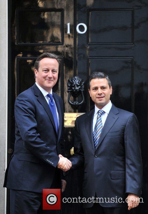 Mexican President-elect Enrique Pena Nieto (R) meets British...