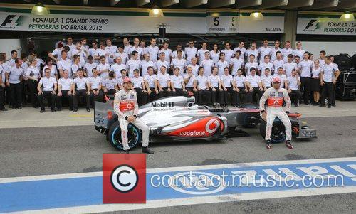 Jenson Button and Lewis Hamilton pose for the...