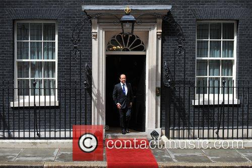 French President Francois Hollande leaves 10 Downing Street...