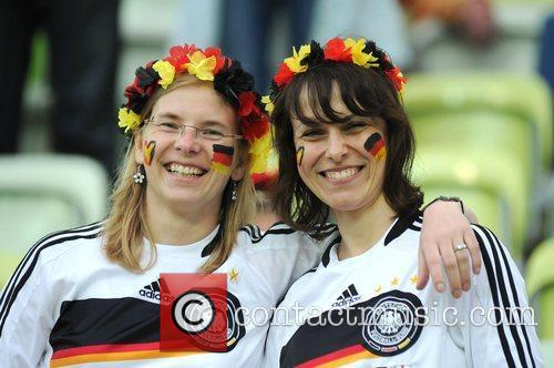 Fans of Germany and Greece show their support...