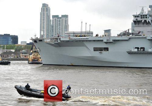The HMS Ocean arrives in London through the...