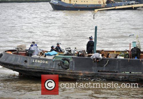 A police team boards a civilian ship that...