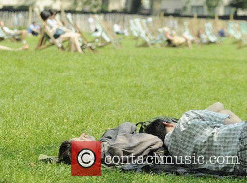 People enjoying the sunny weather in Green Park,...