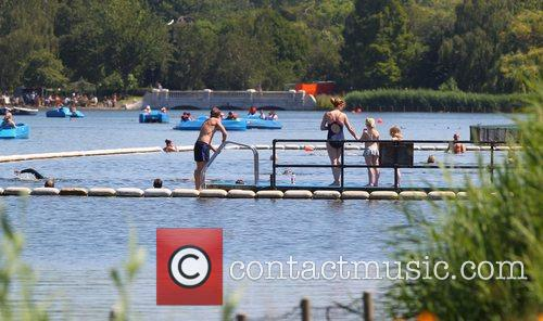 People enjoying the hot weather on The Serpentine...