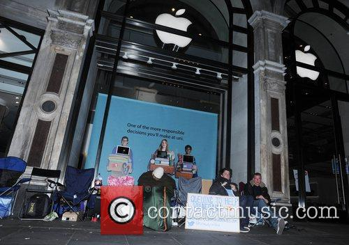 Fans of technology giant Apple, camp outside the...