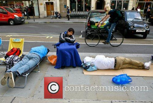 Customers camp outside the Apple store on Regents...