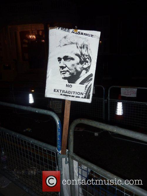 Posters and placards left by protesters outside the...