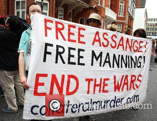 Protesters gather outside the Ecuadorian Embassy where WikiLeaks...