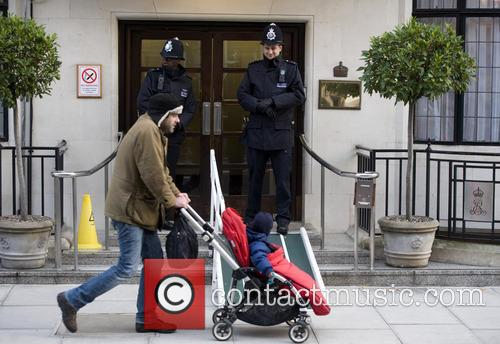police officers guard an entrance to the 20015716