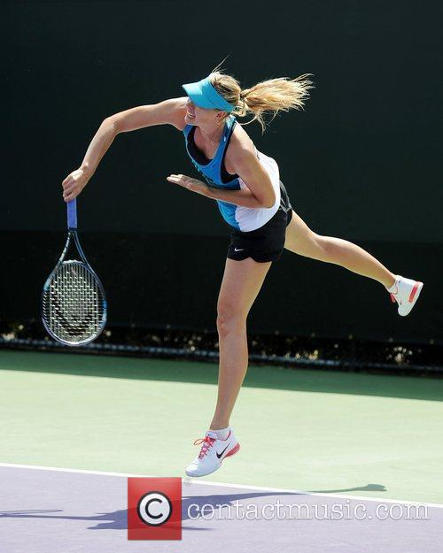 Maria Sharapova warms up prior to participating in...