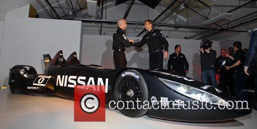Drivers Marino Franchitti and Michael Krumm shake hands...