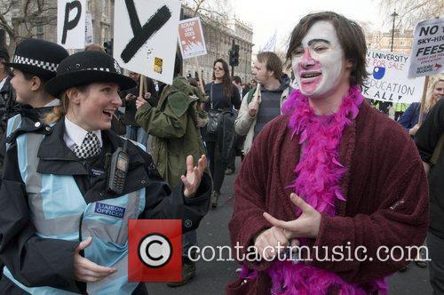 Protestors march through central London