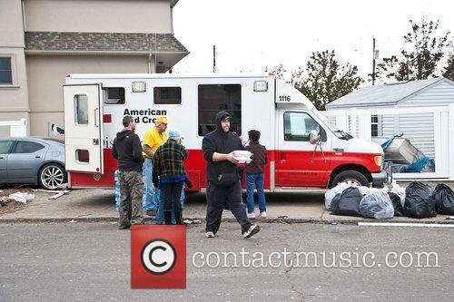 Atmosphere  A Red Cross van distributes food...