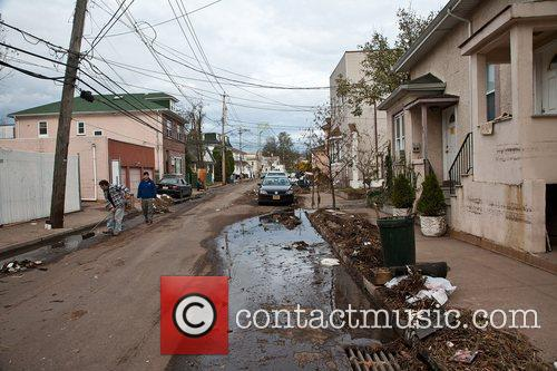 Atmosphere  Residents attempt to clean up the...