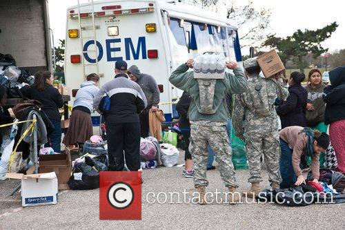 Atmosphere  The National Guard distribute food and...