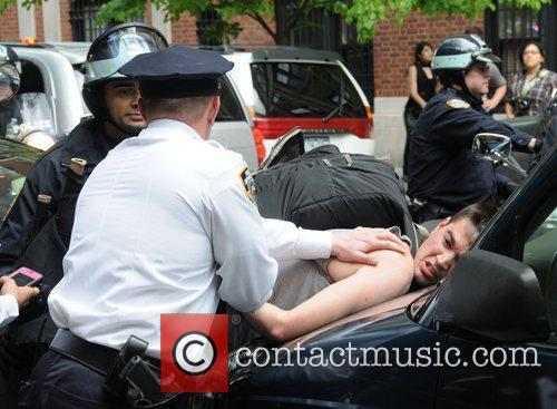 Policemen arrest a protestor during the Occupy Wall...