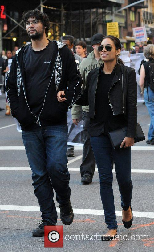 Rosario Dawson walking with a friend during the...