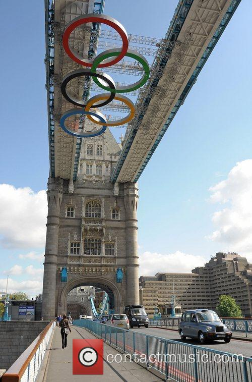 Olympic Rings hang from the gantry of Tower...