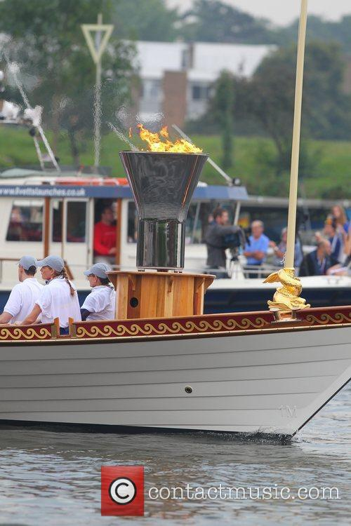 The Olympic Torch Flotilla leaves hampton court and...