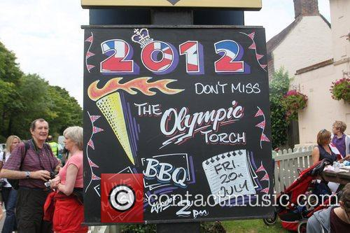 Atmosphere Torchbearers carry the Olympic Torch through Bletchingly...