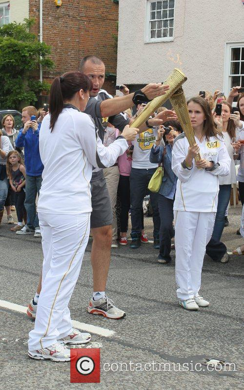 Atmosphere Torchbearers exchange Olympic flames in Bletchingly on...
