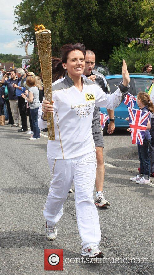 Hayley Fordham Torchbearer 088 carries the Olympic Torch...