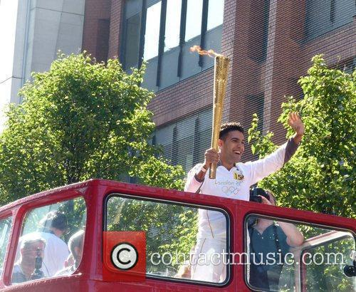 The Olympic torch passes down Oxford Street