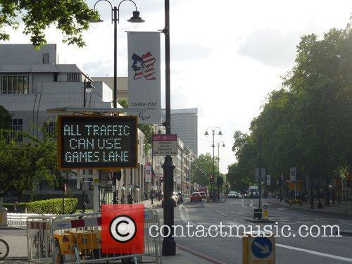 Olympic temporary sign instructing drivers can use Games...