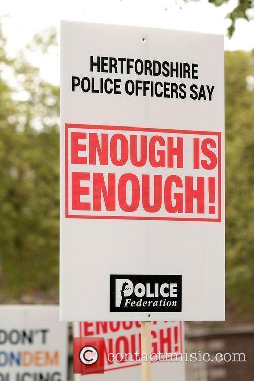 Around 40,000 British Police officers join the 400,000...