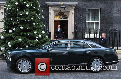 Atmopshere Queen Elizabeth II is met by Prime...
