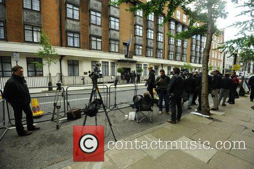 Press gather at the King Edward Hospital where...
