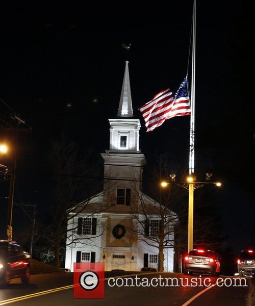A U.S. flag flies at half-staff on Main...