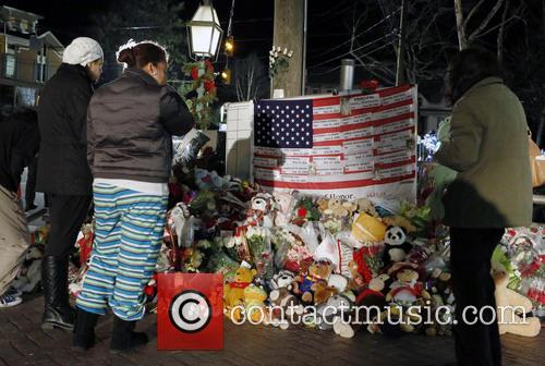 Mourners look at the names on a U.S....