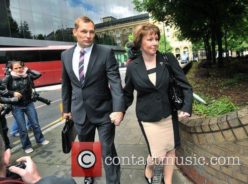 PC Simon Harwood (L) arrives at Southwark Crown...